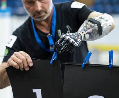 Man cliping paper to a line with the use of a robotic arm