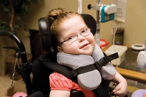 Child in wheelchair with neckbrace